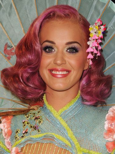 She transitioned her super-dark tresses to a shade of super-bright pink.