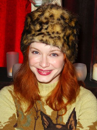 <i>Mad Men</i>'s Christina Hendricks made a furry leopard print hat look chic in the back country by pairing it with a funky woodsman sweater and a huge grin.