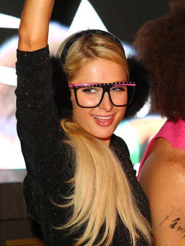 Celebutante Paris Hilton rocked out at TAO Nightclub at The Lift in these uber-cool black furry earmuffs.