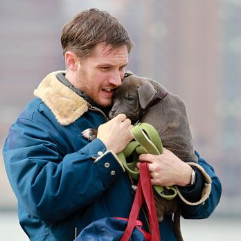While on set of <i>Animal Rescue</i>, Tom Hardy was put on dog duty. Man do we wish we were that pup right now.