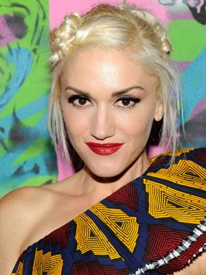 The singer is known for her red lips, platinum hair and quirky style. <br /><br /> <b>Get the look:</b> Start with a crimson pout and a sweep of liquid liner. Then, try a cute, knotted hairstyle like this one to channel Gwen's No Doubt days. <br /><br /> <b>Bonus points:</b> Two kids to play Kingston and Zuma.