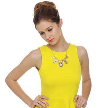 <p>A statement necklace and printed jeans are the perfect pairing to this citrus-colored top. Bonus: its open keyhole back. Can someone say sexy?</p>