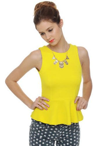 "<p>A statement necklace and printed jeans are the perfect pairing to this citrus-colored top. Bonus: its open keyhole back. Can someone say sexy?</p> <p>Lulu's Good Sport Bright Yellow Tank Top, $30, <a title=""lulus"" href=""http://www.lulus.com/products/good-sport-bright-yellow-tank-top/49043.html"" target=""_blank"">lulus.com</a>.</p>"