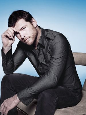 """Just as Russell Crowe and Brad Pitt are getting a little too old to fulfill our hottie- action-hero fantasies, along comes 35-year- old Sam Worthington, with his soulful eyes and the kind of deep, raspy voice that hits you right in the back of the knees. Our crush kicked in when the Aussie actor played a soldier with a heart of gold in <i>Avatar</i> and gained momentum as he showed off more skin and grit in <i>Clash of the Titans</i>. By the time he portrayed a Nazi-hunting secret agent in <i>The Debt</i> this past August, we were sold on him as our Fun Fearless Male of the Year. This month, we're psyched to see this A-list leading man in the thriller/heist flick <i>Man on a Ledge</i>, and he'll soon be donning that thigh- baring tunic again for <i>Wrath of the Titans</i>. Sam claims he's not like the lovable badasses he plays in movies, but after this convo, we're, uh, pretty sure he is.<br /><br />  For more info on Sam, <a href=""""http://www.cosmopolitan.com/celebrity/exclusive/sam-worthington-fun-fearless-male-of-the-year-2012"""" target=""""_blank"""">click here</a>."""