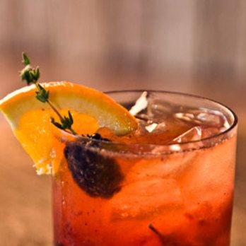 """<i>2 oz. bourbon<br />1 brown sugar cube<br />2 dashes of Fee Brothers Orange Bitters<br />2 blackberries<br />1 orange wedge<br />1 thyme sprig<br />Splash of club soda<br />Garnish: thyme-blackberry (blackberry poked through with a thyme sprig)</i><br /><br />Muddle brown sugar cube in the bottom of a glass with the Bitters, blackberries, orange wedge and thyme sprig. Pour in bourbon, fill with ice cubes, and stir. Top off with a splash of club soda, and garnish with a thyme-blackberry.<br /><br /><i>Source: Edward Lee, <a href=""""http://610magnolia.com/"""" target=""""_blank"""">610 Magnolia</a> Executive Chef</i>"""
