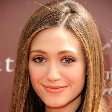 Stick-straight hair, like Emmy Rossum's, is a fail-safe style, since it always looks polished <i>and</i> sleek.