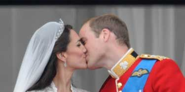 """On April 29, Will and Kate said """"I do"""" while millions of people watched around the world. They also shared this sweet kiss on the balcony at Buckingham Palace."""