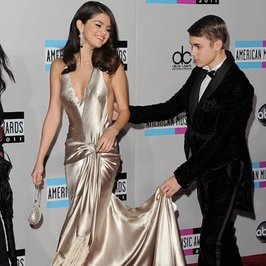 "Allowing her to walk in front is a sign of respect, as well as a clue that she might be in charge in the relationship explains Blanca Jiméned Cobb, a senior instructor at the Body Language Institute in Washington, DC. And the Biebs' hand placement shows that he literally has Selena's back. ""Touching the back is a protective gesture men use to let a woman know he's there for her,"" says Cobb."