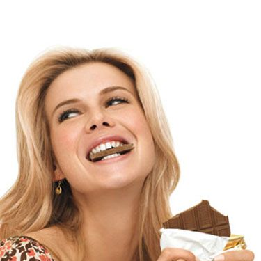 Having a fully-loaded candy bar every day at 3 p.m. won't help your bikini bod. And we get it—it's a hard habit to break. You can have your chocolate and stay trim too by snacking on a 1.6 ounce bar of dark chocolate instead. It's actually good for your heart, since it's loaded with flavonoids, and that small serving won't make you pack on lbs.