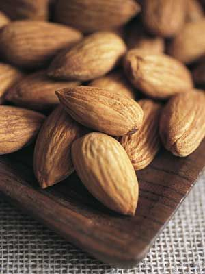 Almonds and pistachios are great, non-bloating snacks—provided they're unsalted, says Bauer. Their high-protein count also helps you feel fuller, faster.
