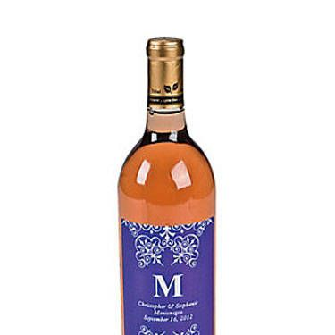 Booze: Best party gift ever?! Just slap these crazy-cheap custom wine labels (which come in a variety of colors) on a bottle of two-buck chuck and send everyone home with a favor they'll actually use.<br /><br />