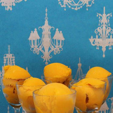 <i>¼ c. Sauza Blue 100% Agave Tequila<br />1 pint mango sorbet<br />1 c. orange juice<br /><br /></i>Combine all ingredients in a blender. Blend until smooth. Add tequila. Pour into a container and place in freezer for eight hours.