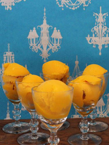 <i>¼ c. Sauza Blue 100% Agave Tequila<br /> 1 pint mango sorbet<br /> 1 c. orange juice<br /><br /></i>  Combine all ingredients in a blender. Blend until smooth. Add tequila. Pour into a container and place in freezer for eight hours.