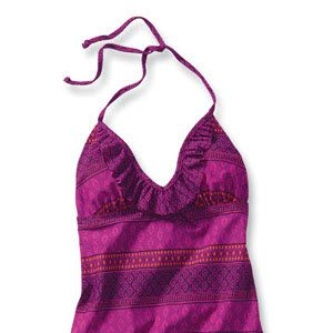 "<p>Get the best of both worlds with this tantalizing tankini. Bohemian print halter top features an ultra-flattering, curve-enhancing ruffle trim. Pair with a solid bottom in neon Posh Purple to complete the look. <br /> <br /> <strong>All Swim on Sale 6/14 - 6/27</strong> <br /> <a href=""http://ad.doubleclick.net/clk&#x3B;258524348&#x3B;82746877&#x3B;d?http://oldnavy.gap.com/browse/category.do?cid=5402"" target=""_blank"">Check out this season's trendiest swimsuit styles!</a></p>"