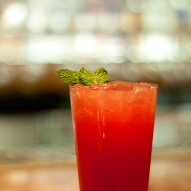 """<i>5 raspberries<br />¼ kiwi<br />½ lemon<br />1½ oz. raspberry vodka<br />Splash of simple syrup<br />Splash of white cranberry juice<br />Ginger beer<br />Club soda<br />Garnish: mint sprig</i><br /><br />To make simple syrup, mix equal parts hot water and sugar until sugar is dissolved. Muddle raspberries and kiwi in a cocktail shaker. Add ice and add remaining ingredients. Shake vigorously and strain into a glass filled with ice. Top with ginger beer and club soda. Garnish with a mint sprig.<br /><br /><i>Source: <a href=""""http://www.cosmopolitanlasvegas.com/taste/restaurant-collection/holsteins.aspx"""" target=""""_blank"""">Holsteins at The Cosmopolitan of Las Vegas</a></i>"""