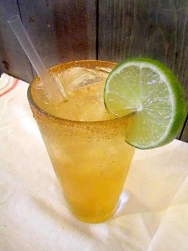 """<i>5 oz. Stella Artios Beer<br /> 1 oz. Don Julio Tequila Reposado<br /> 1/2 lime, juiced<br /> 3 dashes of hot sauce<br /> Garnish: orange twist</i><br /><br />  Combine all ingredients in a cocktail shaker. Shake vigorously and pour into a glass filled with ice. Garnish with an orange twist.<br /><br />  <i>Source: <a href=""""http://www.ainsworthnyc.com/"""" target=""""_blank"""">The Ainsworth</a></i>"""