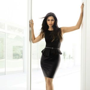 """Here Camilla rocks a hip hugging chic black dress, the type that she says is her favorite look. """"It's sexy without out being too much. I like to accentuate my curves without going overboard."""""""