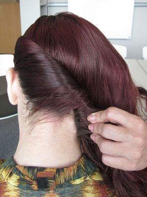 Grab the side that has more hair depending on where you made the part, and begin making a twist starting from the top and working your way back.