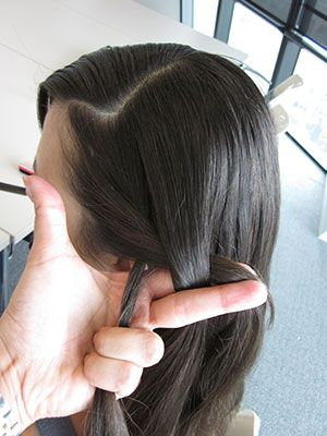 Start braiding the hair downward. Go over and under about two times.
