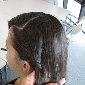 As you continue to braid in a downward slant, grab a new piece of hair and work into the mix each time, similar to the way you'd make a classic French bread. The only difference is that you are braiding half-way around your head, rather than just straight down (see the next photo).