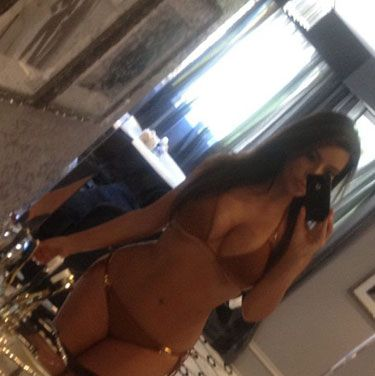 Sure, Kim Kardashian always looks good in a bikini, but we keep looking at this pic because it's <i>interesting</i>. <br /><br /><b>Copy It</b>: Tilt your camera a little to one side and shoot yourself in a room where there's a lot going on.