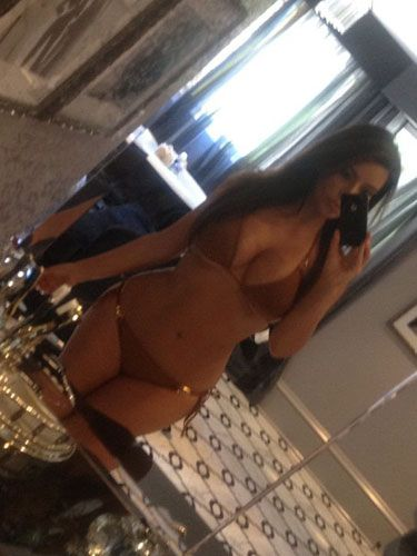 Sure, Kim Kardashian always looks good in a bikini, but we keep looking at this pic because it's <i>interesting</i>. <br /><br /> <b>Copy It</b>: Tilt your camera a little to one side and shoot yourself in a room where there's a lot going on.
