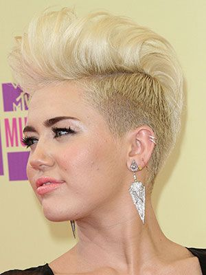 Miley Cyrus's dramatic haircut may have gotten mixed reviews when she first unveiled it, but we love how she switched the look up with a badass mohawk. We're always a fan of bold looks.