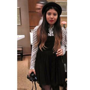 <p>A bowler hat, polka-dot blouse, and overall dress, paired with baby blue mary janes takes it back to school-girl days. Liz Moreno.</p>