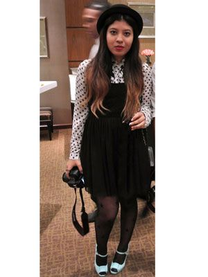 """<p>A bowler hat, polka-dot blouse, and overall dress, paired with baby blue mary janes takes it back to school-girl days. Liz Moreno.</p> <p>Debbie K, blogger and photographer, <a href=""""http://panamastreetstyle.com/"""" target=""""_blank"""">Panama Street Style</a></p>"""