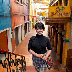 <p>A trendy skull and rose print bag instantly amps up a mock-neck top and plaid skirt getup. Glenda Canizales, owner of Mua Cafe, a coffee shop, boutique, and performance space,located on Pasaje Gomez in Tijuana.</p>