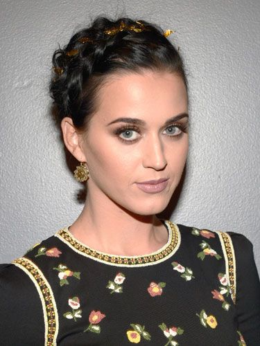 Katy Perry wove a piece of sparkly metallic tinsel throughout her French braided upsweep for an unexpected dose of dazzle.