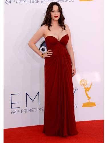 <i>2 Broke Girls</i> star Kat Dennings showed off sexy cleavage in J. Mendel.