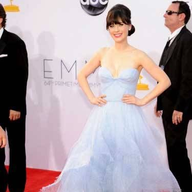 "We love <i>New Girl</i> star (and <a href=""http://www.cosmopolitan.com/celebrity/exclusive/zooey-deschanel-october-cover-cosmopolitan"" target=""_blank"">October Cosmo cover girl</a>!) Zooey's floaty gown."