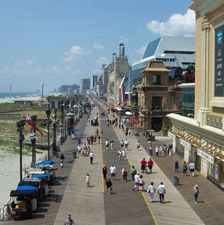 <p>Stroll the legendary boardwalk, which dates back to 1870, filled with shops, restaurants and a seasonal amusement park. Or soak up the sun on the famous beach.</p>