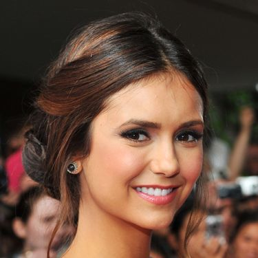 Twists, tendrils, and braids: There's a lot going on with Nina Dobrev's 'do&#151&#x3B;and we like it! Oh, and don't worry, it only <i>looks</i> complicated.<br /><br />