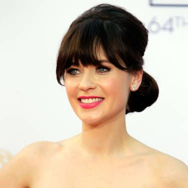 Volume at the crown and a tucked-under chignon creates a vintage vibe like Zooey Deschanel's. But don't let the structured style intimidate you&#151&#x3B;all you really need is a good brush and some bobby pins.<br /><br /><b>Make it your own:</b> Gather the top section of your hair&#151&#x3B;from your hairline to the crown of your head&#151&#x3B;and back-brush it (aka tease it) using a boar-bristle brush. Try Wigo Cushion 100% Boar Bristle Brush, $25, ulta.com.<br /><br />Next, smooth the top layer with the same brush and pull that hair into a ponytail so that it lines up at eye level. Then gather the rest of your hair into a second ponytail, positioned just underneath the first. Combine both ponytails together and tease the under layer. Smooth your strands with your brush and roll the ponytail up into the nape of your neck. Crisscross your bobby pins to secure.