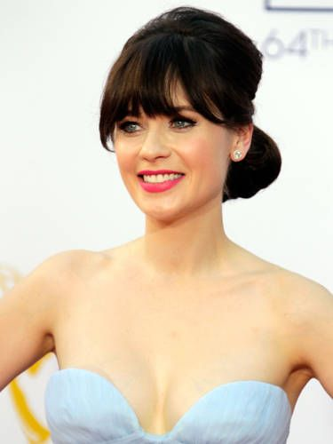 Volume at the crown and a tucked-under chignon creates a vintage vibe like Zooey Deschanel's. But don't let the structured style intimidate you&#151;all you really need is a good brush and some bobby pins. <br /><br /> <b>Make it your own:</b> Gather the top section of your hair&#151;from your hairline to the crown of your head&#151;and back-brush it (aka tease it) using a boar-bristle brush. Try Wigo Cushion 100% Boar Bristle Brush, $25, ulta.com. <br /><br /> Next, smooth the top layer with the same brush and pull that hair into a ponytail so that it lines up at eye level. Then gather the rest of your hair into a second ponytail, positioned just underneath the first. Combine both ponytails together and tease the under layer. Smooth your strands with your brush and roll the ponytail up into the nape of your neck. Crisscross your bobby pins to secure.