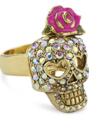 "<p>Celebrate the Day of the Dead in style with a skull or accessory. Don a skeleton-inspired t-shirt or a blinged-out ring like this <a href=""http://www.amazon.com/Betsey-Johnson-Vampire-Slayer-Rhinestone/dp/B006KEMQ02/ref=sr_1_15?s=jewelry&ie=UTF8&qid=1348169659&sr=1-15&keywords=skull&tag=cos_autolinks-20"" target=""_blank"">Betsey Johnson</a> one. You can also add your own twist by painting your nails a <a href=""http://www.cosmopolitan.com/cosmo-latina/belleza-blog/estee-lauder-fall-nail-polish"" target=""_blank"">dark color </a>like our beauty editor Milly did (link to milly's nails) or apply a dark glitter lipstick—here's how to do it (http://www.youtube.com/watch?v=KUZdp8WBiNw). For more cool accessories, click <a href=""http://www.cosmopolitan.com/cosmo-latina/skull-accessories#slide-1"" target=""_blank"">here</a>.</p>"