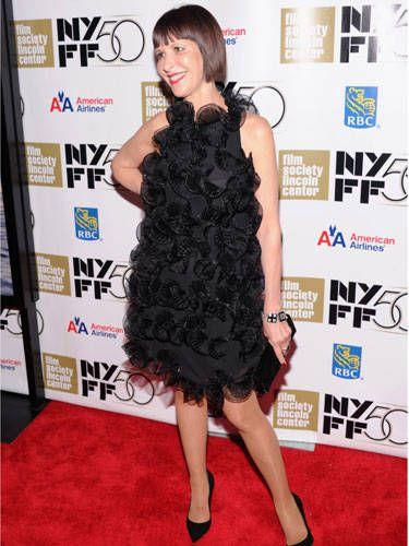 Dress, Hairstyle, Shoulder, Flooring, Joint, Style, Carpet, One-piece garment, Cocktail dress, Premiere,