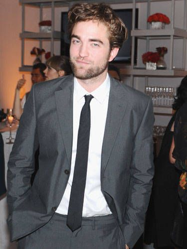 Think you've had a crappy day? R-Patz sitting in the corner, brooding, will remind you it's not so bad after all.