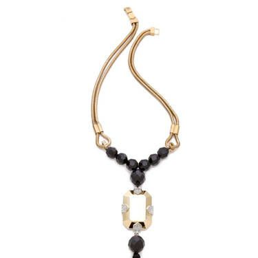 Here's a gorgeous showstopping accessory that makes a huge statement. Be sure to keep the rest of your look pared-down with this flashy tassel pendant dangling off of double-snake strands&#151&#x3B;it demands all the attention.