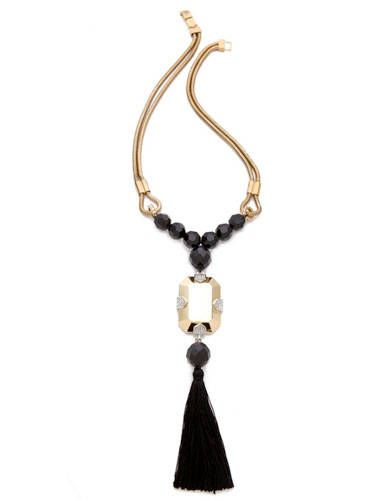 "Here's a gorgeous showstopping accessory that makes a huge statement. Be sure to keep the rest of your look pared-down with this flashy tassel pendant dangling off of double-snake strands—it demands all the attention. <br /><br /> Juicy Couture Large Gemstone Tassel Necklace, $148, <a href=""http://www.juicycouture.com/Large-Gemstone-Tassel/YJRU6196,default,pd.html?dwvar_YJRU6196_color=710&start=5&cgid=jewelry-necklaces"" target=""_blank"">JuicyCouture.com</a>"
