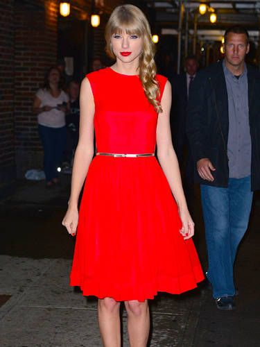 We love this simple red number that Taylor paired with a skinny belt while out promoting her new album, <i>Red</i>. Way to mix business with fashion.