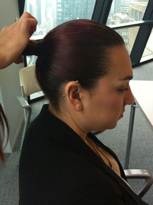 """<p>Comb your hair back into a mid ponytail. Be sure to use a smoothing cream to get a real slicked back look and prevent fly aways. Try <a href=""""http://www.alfaparf.com/index.php?method=section&action=zoom&id=318"""" target=""""_blank"""">Alfaprf Milano Illuminating Smoothing Cream. </a></p>"""