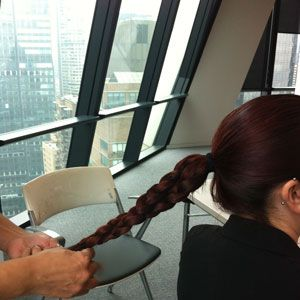 <p>Twist the two braids together.</p>
