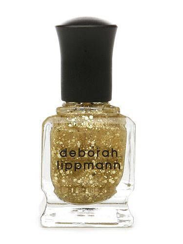 """<p>The quickest, easiest way to get in on the gilded trend is with a show-stoppingly sparkly polish. We love this polish which is a shockingly bold, hyper-gleamy stunner that aims to last up to 10 days, chip-free.</p>  <p><a href=""""http://www.beauty.com/deborah-lippmann-nail-color-boom-boom-pow/qxp310195"""">Deborah Lippman Nail Lacquer in Boom Boom Pow, $20, beauty.com</a></p>"""