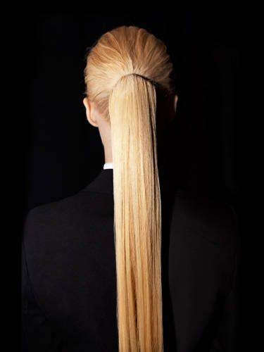 "The hair equivalent of sky-high stilettos, this slick pony shows everyone who's boss. The key: securing it right at the bump behind your head. ""That way, it sticks out farther than a regular pony and makes a bolder statement,"" says stylist Neil Moodie, who did this on the models at the Hervé Léger show. For extra shine and sleekness, flatiron the length of the tail, and apply a dime-size drop of serum (try L'Oréal Paris EverStyle Smooth and Shine Serum, $7). And if your pony's puny or short, try using a fake one (like Hairdo by HairUWear 18-Inch Simply Straight Pony, $49)&#151&#x3B;the model here did."