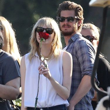 Yeah, they're out in public which can make an all-out makeout sesh awkward. But Andrew Garfield still shows he cares by slipping his hand into girlfriend Emma Stone's back pocket. <i>Aww</i>.