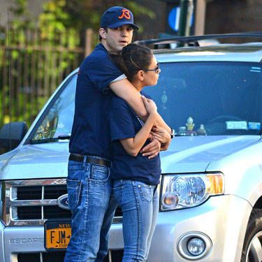 Ashton Kutcher is so into his girl Mila Kunis that he hugs her on the freaking street corner. His arms and lower body are all connected to her&#151&#x3B;a sign that there's huge chemistry between them.