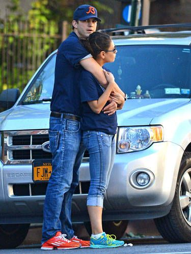 Ashton Kutcher is so into his girl Mila Kunis that he hugs her on the freaking street corner. His arms and lower body are all connected to her—a sign that there's huge chemistry between them.